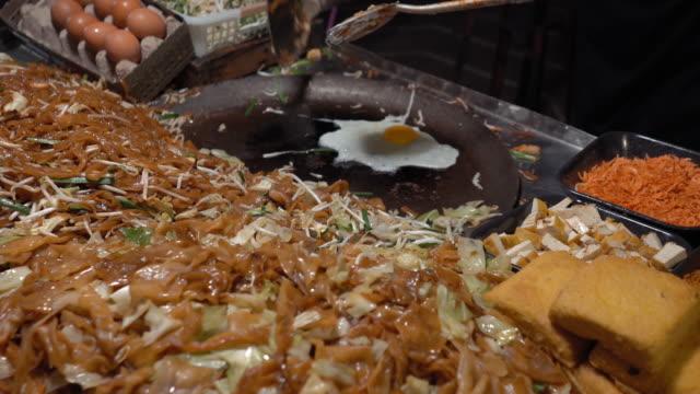 thai regional food backgrounds at night street food - bangkok stock videos & royalty-free footage