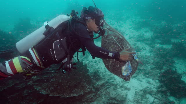 thai scuba diver removing fishing nets underwater andaman sea - aqualung diving equipment stock videos & royalty-free footage