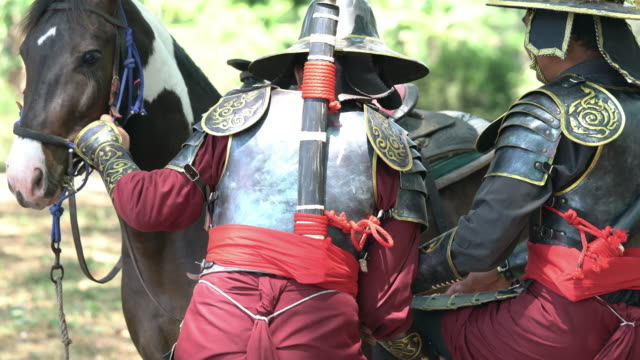 thai soldier with ancient armor riding horse - army helmet stock videos & royalty-free footage