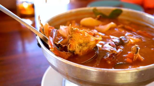 thai soup, sea food and mixed vegetable in orange spicy tamarind and spice soup. - thai food stock videos & royalty-free footage