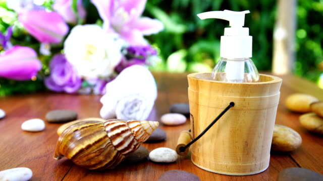thai spa massage setting with bottle essential oil - natural condition stock videos & royalty-free footage