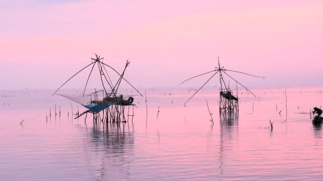 thai style fishing trap in pak pra village.thailand - still life stock videos and b-roll footage