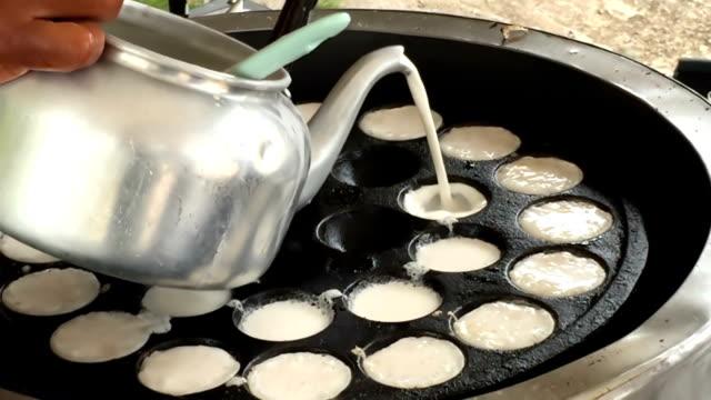 thai sweetmeat coconut milk on hot pan - macaroon stock videos & royalty-free footage