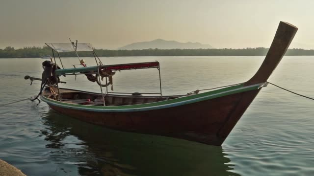 thai taxi boats: traditional wooden longtail boat - ko lanta stock videos & royalty-free footage