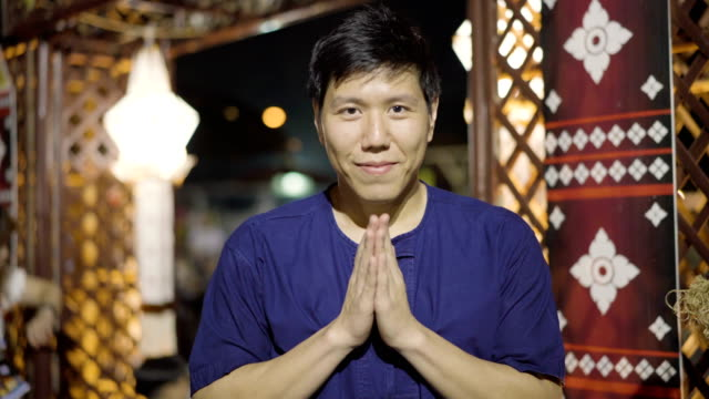 "thai traditional clothing man ""wai"" sawasdee to welcome into local night market - short phrase stock videos and b-roll footage"