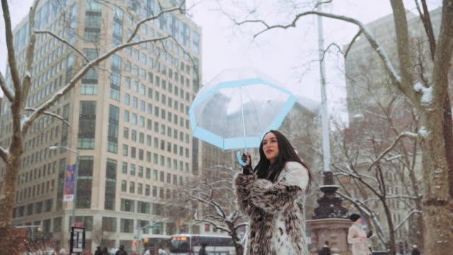 Thai transgender woman enjoying snow, New York City, United States
