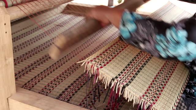 Thai woman hands weaving reed mat video HD.