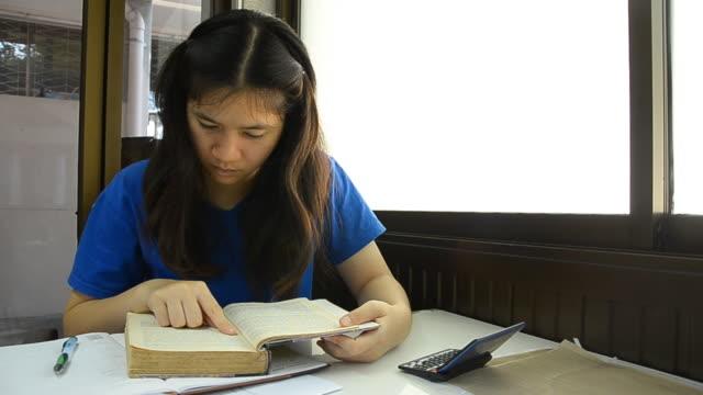 Thai woman suddenly screen a book