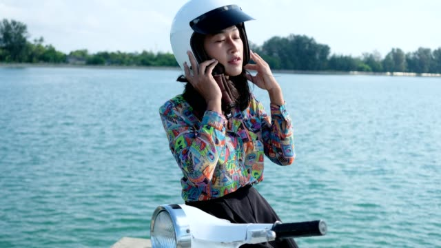 thai women driving retro scooter - sports helmet stock videos & royalty-free footage