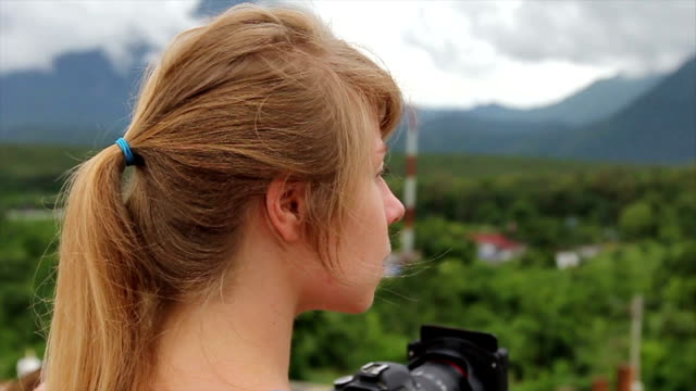 thailand holiday vacation. expat woman with camera - slr camera stock videos and b-roll footage