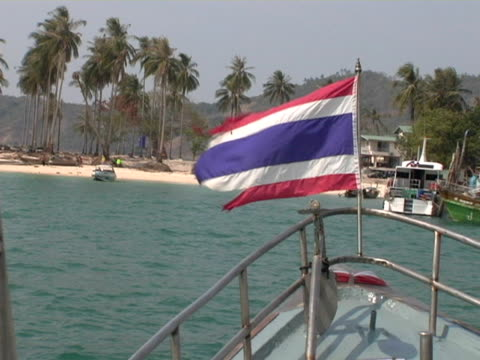 POV, Thailand, Ko Phi Phi, Boat with Thai flag on bow mowing towards beach