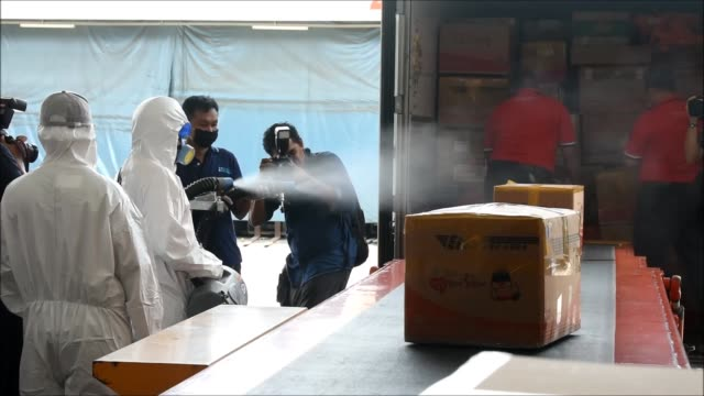 thailand post workers spray disinfectant on parcel boxes from abroad against the coronavirus covid-19 outbreak at thailand post headquarter in... - cleaning agent stock videos & royalty-free footage