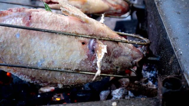 thailand street food grilled fish with salt. - thai food stock videos and b-roll footage