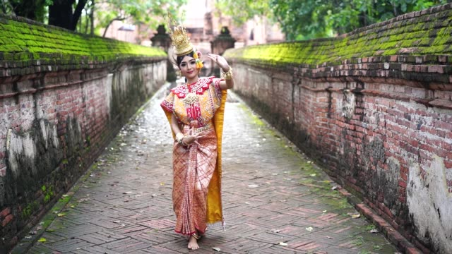 thailand traditional or cultural thai dance. thai beautiful girl is dancing called ram, it is noble thai art of elegance. - nobel prize in literature stock videos & royalty-free footage