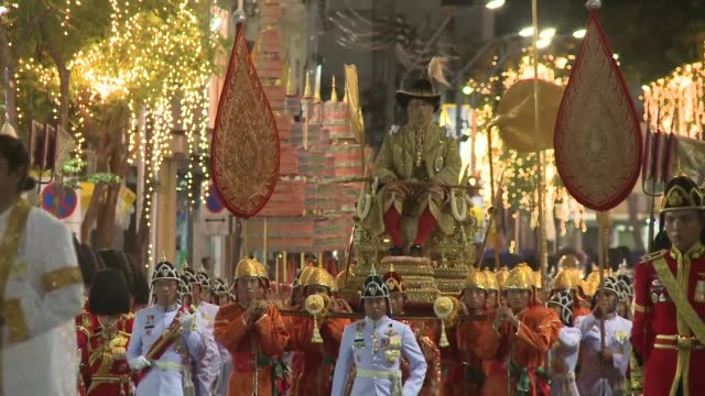 thailand's newly crowned king maha vajiralongkorn is carried by soldiers on a gilded litter by night through the streets of bangkok in front of... - gilded stock videos & royalty-free footage
