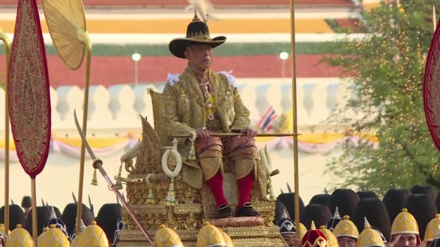 thailand's newly crowned king maha vajiralongkorn is carried by soldiers on a gilded palanquin through the streets of bangkok in front of crowds who... - king of thailand stock videos and b-roll footage