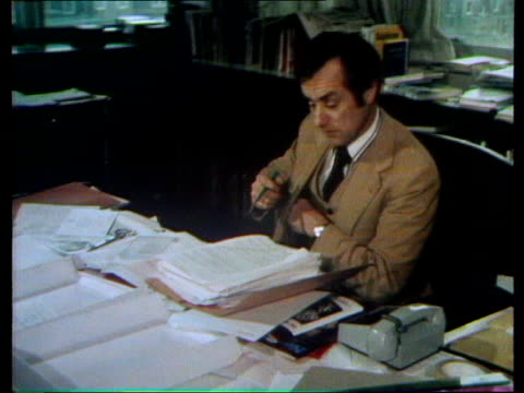 london: gray's inn road: int sunday times editor, harold evans, at desk; pull out: - thalidomide stock videos & royalty-free footage