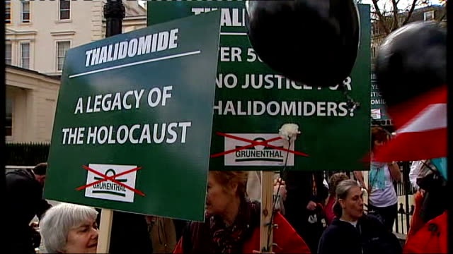thalidomide victims seek compensation; kensington: ext thalidomiders protesting carrying placards - thalidomide stock videos & royalty-free footage