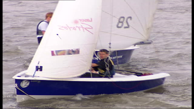 thames barrier closed for second london regatta yachts quickly along river as wind picks up mervin kinnear down to boat in wheelchair via ramp... - boat ramp stock videos & royalty-free footage