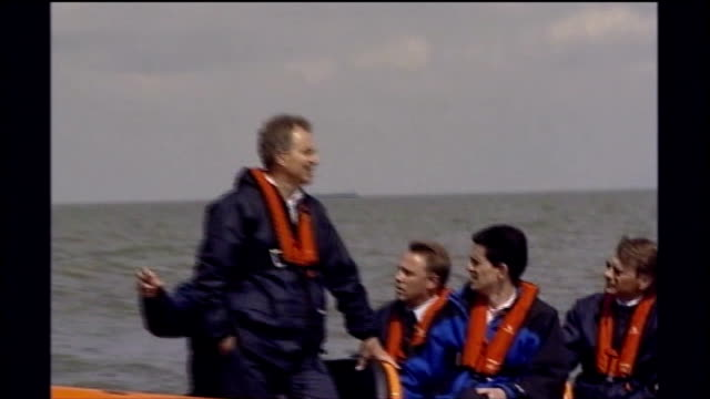 offshore wind farm tony blair mp david miliband mp and others in rubber dinghy on visit to offshore wind farm looking at wind turbines - david miliband stock videos & royalty-free footage