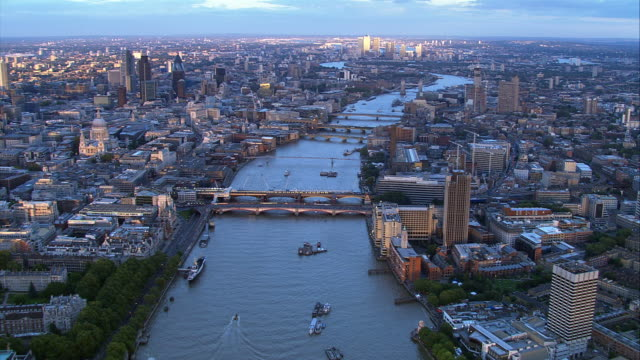 thames river, aerial tracking shot through london - tower bridge stock videos & royalty-free footage