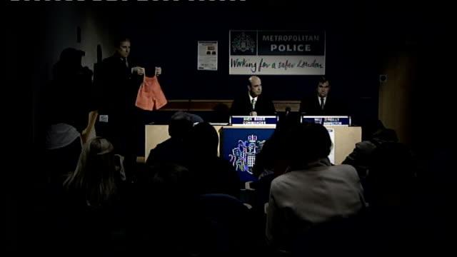 vídeos y material grabado en eventos de stock de nigerian woman reveals identity of boy; tx. int police officer holding up orange shorts at press conference close shot of orange shorts held up - torso