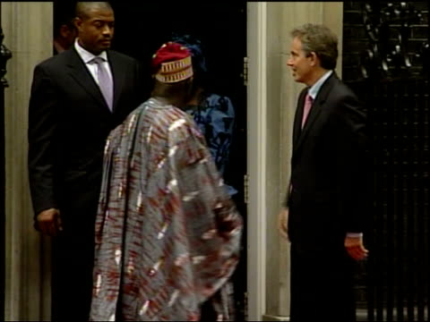 people trafficking network broken bbc england london downing street prime minister tony blair mp out of number 10 with nigerian president olusegun... - torso stock videos & royalty-free footage