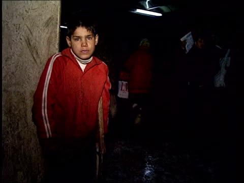 vídeos y material grabado en eventos de stock de people trafficking network broken; lib romania: bucharest: night homeless children on street - torso