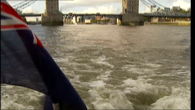 thames water bills set to rise to pay for new london sewer; dates unknown ext fish being held up in net tower bridge sunshine reflecting off river... - moving up点の映像素材/bロール
