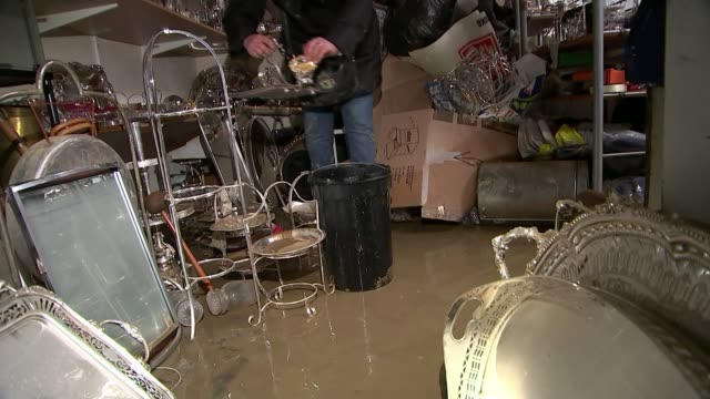 Thames Water ordered to repay 15 pounds to customers for poor performance CUTAWAY London Islington INT Flooded basement of antiques shop