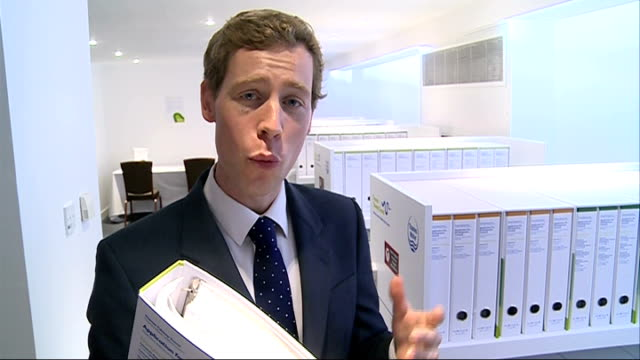 """vídeos y material grabado en eventos de stock de thames water submits planning application for london """"super sewer""""; reporter and philip stride looking at folders containing planning application for... - paso largo"""