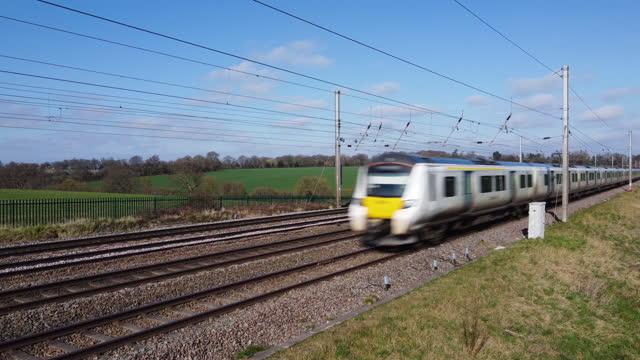 thameslink train travelling towards london. british rail class 700 desiro city. - rail transportation stock videos & royalty-free footage