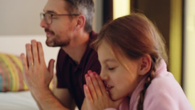 thank god for dads - praying stock videos & royalty-free footage