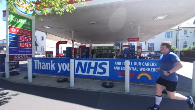 thank you nhs banner at the esso petrol station in east dulwich during the coronavirus pandemic on may 19, 2020 in london, england. the british... - petrol station stock videos & royalty-free footage