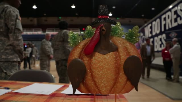 thanksgiving decoration is seen at a table during an operation homefront event to distribute holiday meals at the dc national guard armory - waffenlager stock-videos und b-roll-filmmaterial