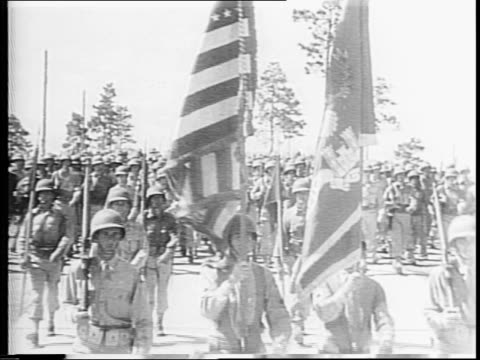 stockvideo's en b-roll-footage met thanksgiving during wartime / american flag waving / montage of africanamerican and other us troops marching flags of the united nations / castle in... - chiang kai shek