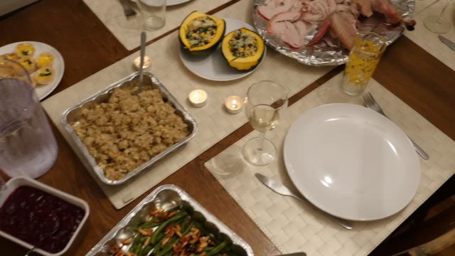 a thanksgiving table, set with traditional food, handheld - roast turkey stock videos & royalty-free footage