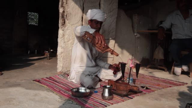 thar desert, rajasthan, india; november 4, 2014; the bishnoi are more of a religious community than an ethnic one. bishnoi drink opium tea. it is... - narcotic stock videos & royalty-free footage