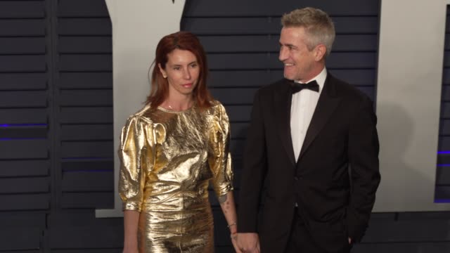 tharita cesaroni and dermot mulroney at 2019 vanity fair oscar party hosted by radhika jones at wallis annenberg center for the performing arts on... - vanity fair oscar party stock videos & royalty-free footage