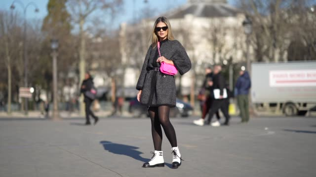 thassia naves wears sunglasses, a neon pink chanel bag, a black and gray jacket, a belt, black tights, black and white shoes with black shoelace,... - gray jacket stock videos & royalty-free footage