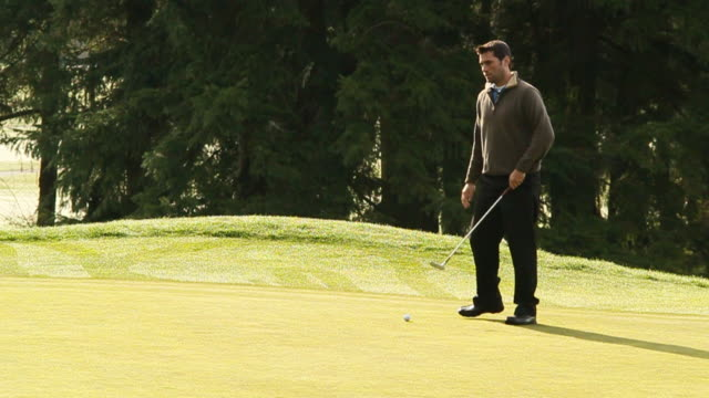 that putt may have gone in - golfplatz green stock-videos und b-roll-filmmaterial