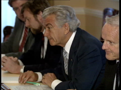 thatcher and hawke seated across each other at table during talks/ sir geoffrey howe and george younger/ defence secretary and lord young/ trade... - bob hawke stock videos and b-roll footage