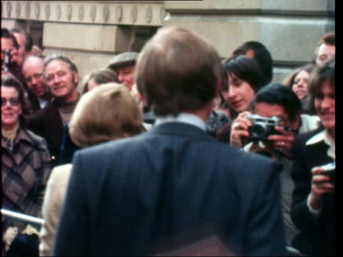 stockvideo's en b-roll-footage met thatcher announces new cabinet appointments; england: london: downing street: ext margaret thatcher outside no 10 chatting with people thatcher along - prime minister
