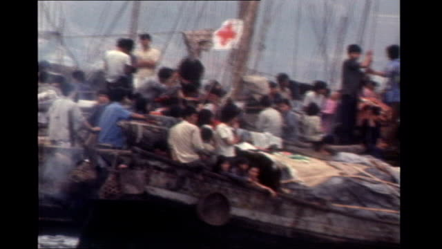 Thatcher era archives released S30100607 Various of Vietnamese boat people crammed in traditional boats sailing in Hong Kong harbour looking for...