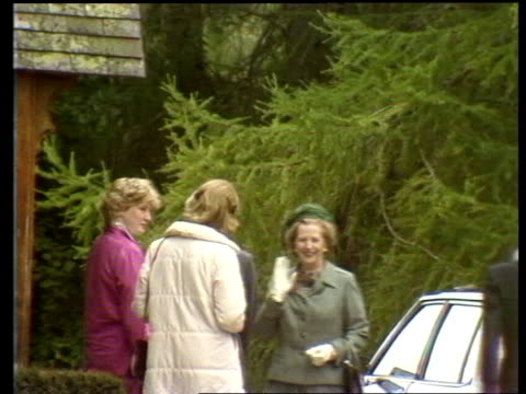 stockvideo's en b-roll-footage met crathie ext **music heard sot** ms pipers lead scottish troops along road from balmoral sof bv away **music ends** ms margaret thatcher stands denis... - 1981