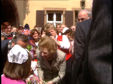 thatcher meets kohl 01 ext 1858 children waiting with bouquets motorcade and thatcher/khol arrival greeted by mayor of deidesheim presentation of... - motorcade stock videos & royalty-free footage