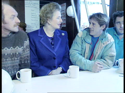 young tory conference2 itn england devon torquay ext prime minister margaret thatcher visiting building site thatcher posing with workers / thatcher... - political party stock videos & royalty-free footage