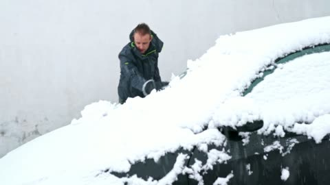 ''that's why i hate snow!''- young man cleaning the snow from a car - slippery stock videos & royalty-free footage