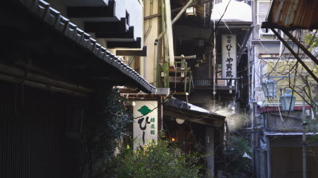 thaw water drips from roof to alley among the ryokan (traditional japanese inn) along the alley at shibu onsen (shibu hot spring) yamanouchi-machi, nagano japan on feb. 18 2019. - jigokudani monkey park stock videos & royalty-free footage
