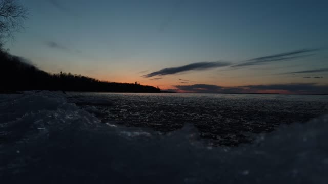 thawing and melting lakeshore - lakeshore stock videos & royalty-free footage